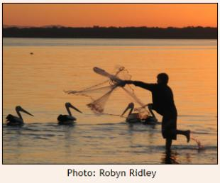 Boy throwing Casting-net at sunset - Bribie Is